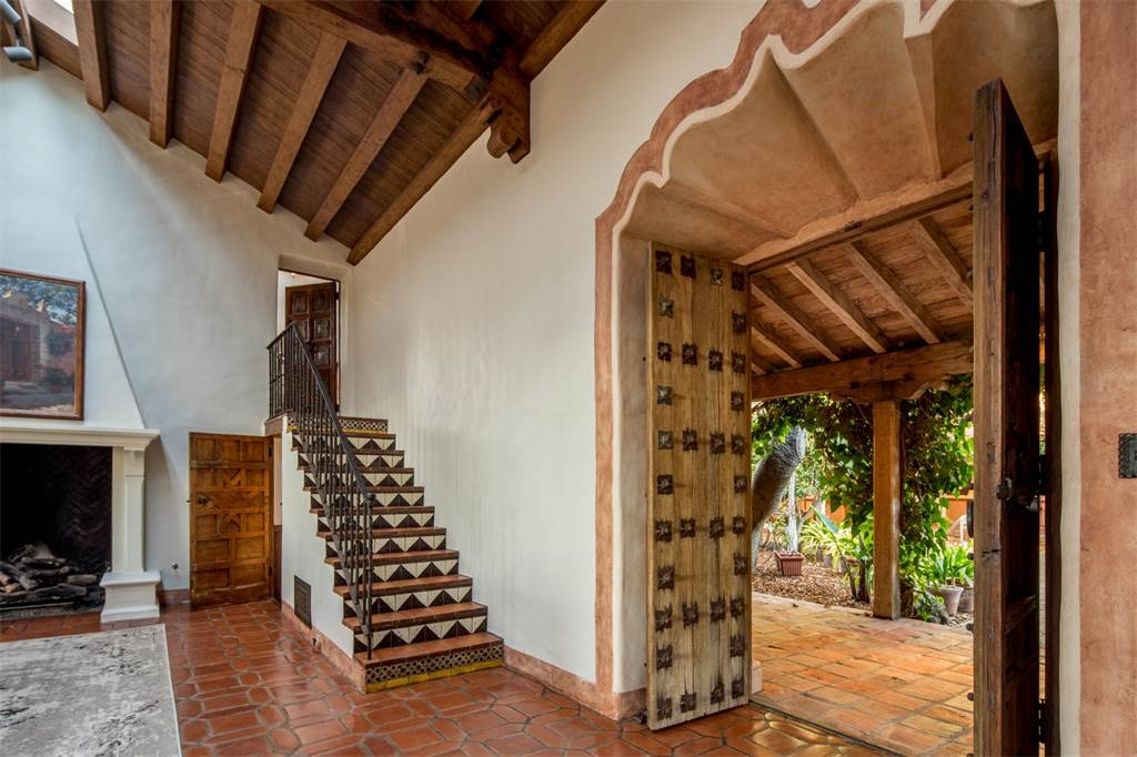 Beamed ceilings and a tiled staircase add plenty of Spanish farmhouse character.