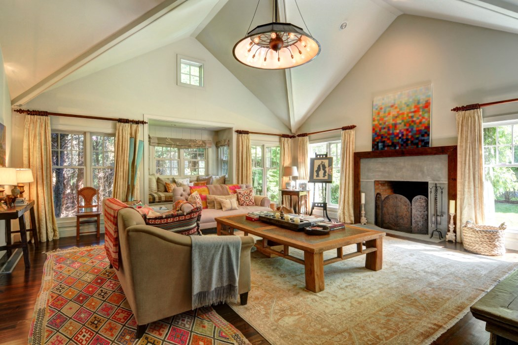 A large stone fireplace anchors the living room.