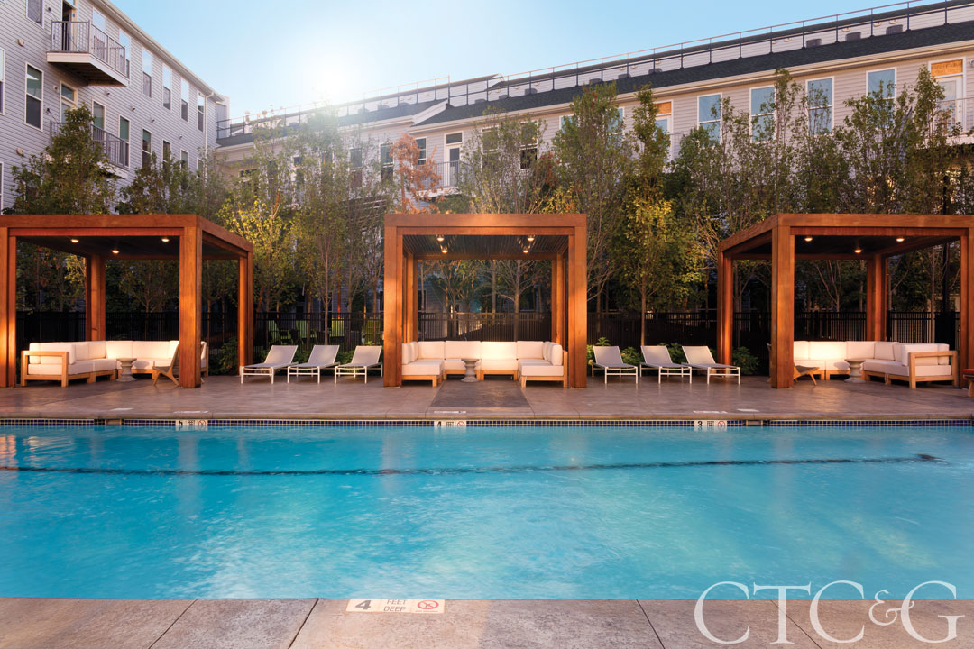 The pool at the Corsair apartment building features poolside cabanas.
