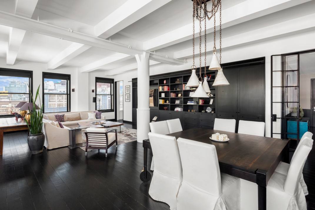 The great room features ebony wood floors and black built-ins.