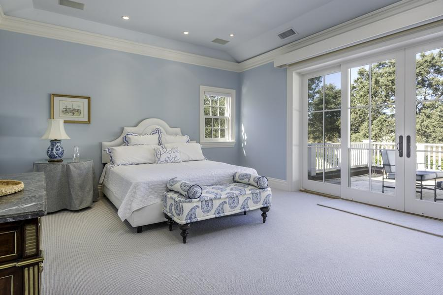 The master bedroom boasts a private balcony.