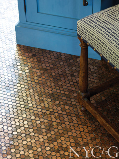 Hand-laid penny tile lines the entry mudroom.