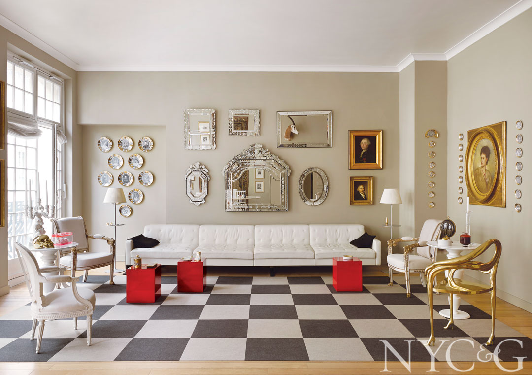 A white leather Kennedee sofa by Jean-Marie Massaud for Poltrona Frau and a checkerboard of Flor carpet tiles anchor the artful living room.