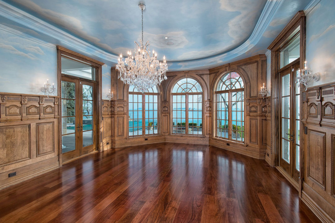 The formal dining room includes a painted ceiling.